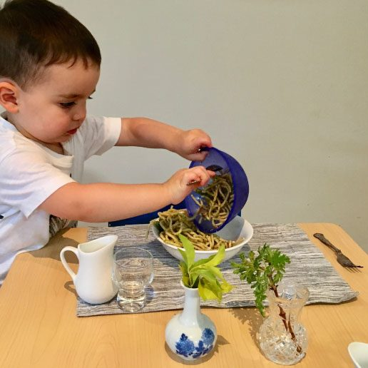 Young student dishes pasta into a bowl